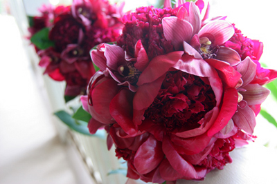 red peonies in bride's bouquet