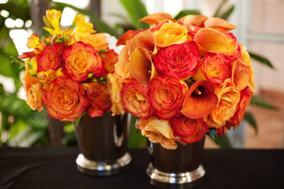 brides bouquet orange roses, orange mini calla lilies, freesia
