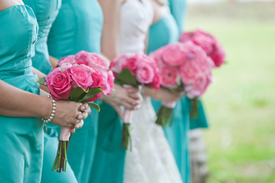 aqau bridemaids with pink flowers