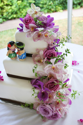 purple orchids on wedding cake