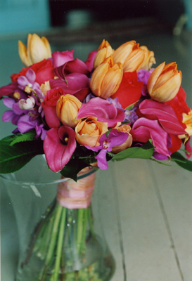vibrant brides bouquet orange tulips, pink mini calla lilies