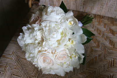 lush peonies with white orchids