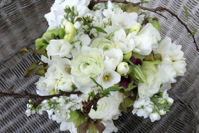 white bouquet with blossum branches