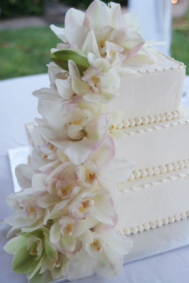 white butter cream cake with orchids