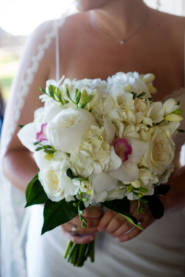 white peonies and orchids brides bouquet