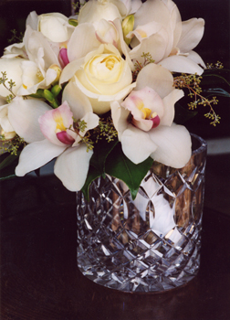 cream roses with white orchids in brides flowers